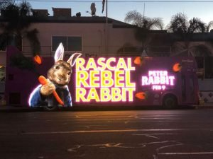Illuminated Rascal Rebel Rabbit bus wrap