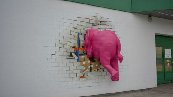 elephant crashing through wall