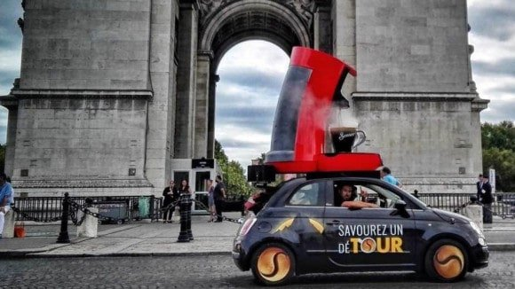 3D printed coffee maker on a car in front of the Arc de Triumph
